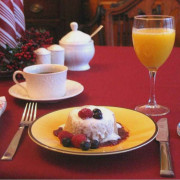 Breakfast being served on the table/ Includes Oatmeal pudding and orange juice
