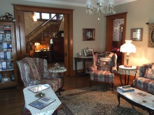Barrister front sitting room. 2 chairs with a couch and end table. A cabinet with brochures and a look at the stair case